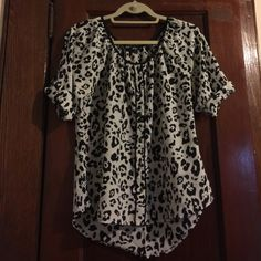 Express black and white button down blouse Express black and white animal print button down blouse 🔹 this is not form fitting, it's loose but better for women with a small bust 🔹perfect for work or a night out 🔹 no snags or stains 🔹 good condition 🔹 price firm 🔹 Express Tops Blouses