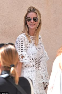 Daring: Ivanka, who usually sticks to floral fit-and-flare dresses and doesn't show much skin, was spotted wearing a laser-cut white top that showed her white bikini underneath