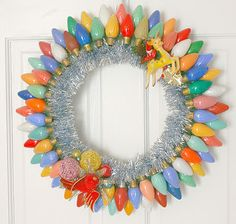 Vintage tinsel wreath adorned with big colored lights...very retro and very pretty!