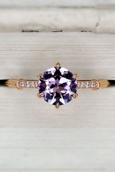 Inspired by our romantic dreams, this recycled rose gold ring is our latest masterpiece! Centered upon an enchanting firey fine Spinel this gem sparkles with vivid and rich pink and purple flair. The ring is fashioned in a glamorous and romantic Art Deco-inspired style with an elegant band. Six single eagle claw prongs hold the center stone in an antique Georgian style Collet setting. Rose Gold Pink, Pink Purple, Budget Friendly Engagement Rings, Eagle Claw, Rose Gold Engagement Ring, Georgian, Gold Ring, Sparkles, Diamond Cuts