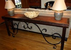 Old world console table made from an old door and a piece of fencing...