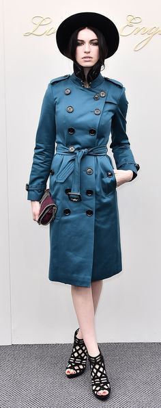 Tali Lennox wearing a trench coat to the Burberry show in London's Kensington Gardens