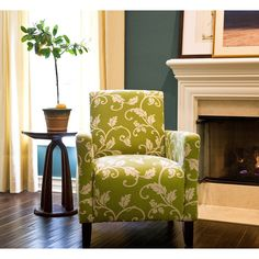 Bring a delightfully traditional touch to your home with this elegant accent arm chair. Featuring a cream leaf and vine design, this durable and comfortable deep-seat green chair with a walnut finish will easily accentuate your room's decor.