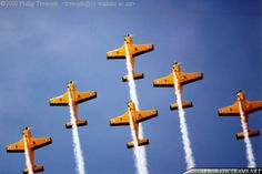 """The """"Red Checkers"""" are the current Royal New Zealand Air Force (RNZAF) aerobatic display team.The team consists of seven CT-4E Airtrainers piston-engined aircraft, of which only five participate in airshows.The airplanes are painted in an overall yellow color and are each equipped with white smoke ..."""