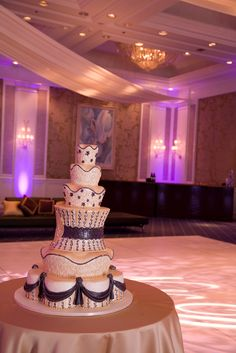 This towering cake from cakelava looks even more decadent in the decorated Ocean Ballroom of the Ihilani.  Photo by Sieber Studio.