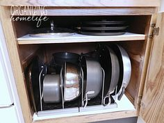 To keep you little piggies safe, use organizers that let you stack items on their sides. Then, all you have to do when you need a pan is pull it out without having to worry about causing a kitchen disaster. See more at Organizing Home Life »   - HouseBeautiful.com