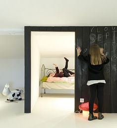 Embrace the challenging walls of a vaulted room or attic by creating a super fun room-within-a-room for the kids.