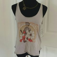 """NWT Free People Boho Graphic  Tank Super cute soft stretchy material tank from FP. Nwt, never worn in perfect condition. Tagged XS but truly a S or M. Mannequin is a true sz M and tank is still baggy and flowy. Price flexible, please feel free to make an offer using the """"offer"""" button ! I love negotiating price :) Free People Tops Tank Tops"""