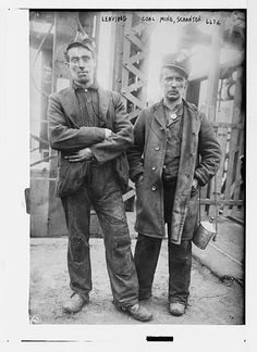 1912. Two miners ready to leave entrance of coal mine near Scranton, PA.