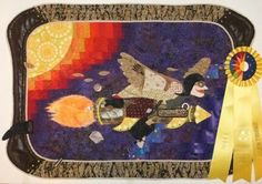 """Icarus, Take Two,"" made for 2011 Jacksonville Quiltfest.  As fun as Icarus was to make, the border is my favorite part."