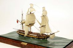 "HMS Diana By: Phillip S. Reed  This miniature waterline model depicts a fifth-rate 38-gun frigate of the Artois-class built in 1794 by Randall & Brent, at Rotherhithe, London, England.    Size: 21 1/2"" x 11 5/8"" x 14 1/4"""