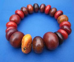 A wonderful collection of dark red 'African Amber' beads from the collection of Carl Dreibelbis | Worth noting that although highly collectible and often referred to as 'African Amber' or 'Copal' Amber, in reality they are made from an early plastic material called Phenolic Resin.  These beads were made in Germany in the 1920s to the 1940s and traded throughout Africa and other areas, either as Amber or as an Amber substitute.