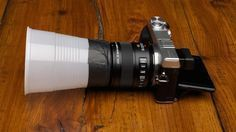 Here's a simple trick for improving the lighting in your macro photographs: use a cheap plastic cup around your lens.