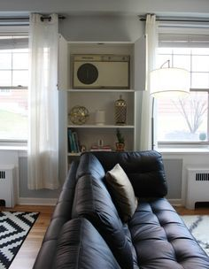 It's a small price to pay for a lovelier look whenever you're not blasting the air. #ikeahack #decorideas Ikea Billy Hack, Ikea Billy Bookcase Hack, Ikea Shelves, Billy Bookcases, Built In Wall Units, Modern Wall Units, Built In Bookcase, Wall Unit Ac, Shelf Units