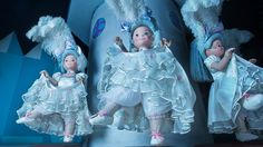 Three French can-can dancer dolls dressed in blue costumes