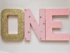 "Pink and Gold Glitter Stand Up ""ONE"" Letter Sign-First Birthday-Photo Prop-Party Decor-Paper Mache-Decoration-Twinkle Twinkle Little Star by ZoeyElisa on Etsy https://www.etsy.com/listing/492085182/pink-and-gold-glitter-stand-up-one"