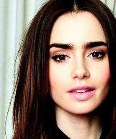 beautiful!!!! with bold bushy brows, light gold, pointy lashes, soft make up, straight hair