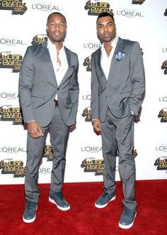 Singers Tank and Ginuwine aka the 2/3 of TGT, minus Tyrese, looked nice in their grey suits and white shirts.