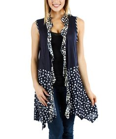 Take a short vest and add a bottom skirt.  Put a ruffle down the front and around the neck.