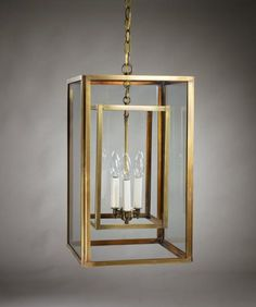 "Union Square hanging lantern; comes in dark brass finish; clear or seeded glass and can custom make sizes, but do not make 8"" in this style; really like this one /copperlanternlighting.com"