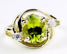 R021, Manchurian Peridot, 10KY Gold Ring  * Stone Type - Manchurian Peridot * Approximate Stone Size - 10x8mm  * Approximate Stone Weight - 3.3 cts  * Jewelry Metal - Solid 10k Yellow Gold * Approximate Metal Weight - 3.9 grams  * Ring Size - Size selectable during checkout * Our Warranty - A full year on workmanship  * Our Guarantee - Totally unconditional 30 day guarantee
