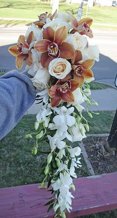 Gorgeous Cascade Bouquet with Ivory Roses, Cymbidium Orchids, and Dendrobium Orchids Orchid Bouquet, Cascade Bouquet, Orchid Flowers, Dendrobium Orchids, Ivory Roses, Bride Bouquets, Wedding Flowers, Photo Galleries, Wedding Photos