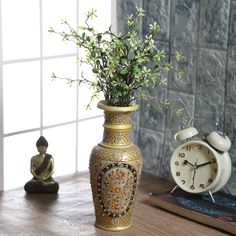 This vase is a multicolor which is made from marble. It will give you a marvelous look to your house.