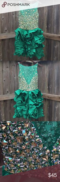 "💋🔥💃🏻 Cinderella Sheer Mini Dress Size 6 Prom GORGEOUS Sheer Mini Dress in a Sexy Bright Emerald Green.  All Eyes On You! Bodice Features Hand Beaded Rhinestones, Sequins & Beads to Bring All Eyes to the Sheer Tulle Panel.  Impress from the Back with a Plunge Cut.  Rose Appliqués in the Skirt Add a Touch of Class To Your Sass! Prom, Wedding, Party! MSRP $136!  Sz 6, 100% Polyester, Slip on With Quarter Zip at Back, Waist: 13.25"", Bust: 16"", Length: 32"". Looks Great, Worn once & beading…"