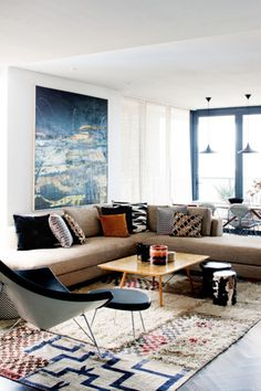 * Love the L shape of the couch- more openness   * The little things matter- bringing out one color: Navy blue- you see it brought out over the entire room  living room