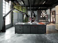 industrial-loft-kitchen-furniture-with-built-in-sink-and-electric-cooktop-kitchen-island-under-black-vent-hood-also-black-4-doors-freestanding-pantry-cabinet.jpg 933×700 pixels