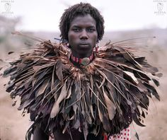 Africa | A #Maasai Moran at an Eunoto ceremony wears a rare elaborate feather Ruff.