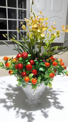Vaso com flores artificiais para mesa