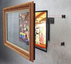 TV Frame & TV Mirror - Wall mounted installation method with L - Brackets. Put a two way mirror tent on the glass so the tv looks like a mirror when it is turned off Tv Escondida, Deco Tv, Ideas Cabaña, Decor Ideas, Mirror Tv, Tv Covers, Hidden Tv, Framed Tv, Moroccan Decor