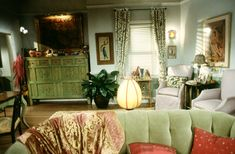 Does anyone know where I can find a piece of furniture like the green dresser in the back left corner?