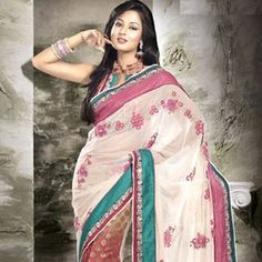 Weddings are the once a lifetime occasion, which has its everlasting memories in the bride's life. Unique Red & Ivory Embroidered Saree is the lastest fashion in current time.Every women wants to look very delegant in parties and ceremony functions.Gravity fashion provide you saree with best quality and best price.