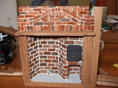 fireplace - finish detail - a wash for your grout color it is about 1/2 cup water with 2 drops pf Hippo Grey and 1 drop of black paint added.