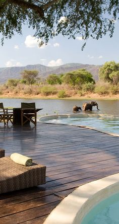 The pool at safari lodge Chongwe River House overlooks the mountains of the Lower Zambezi and the Chongwe River, where animals come to bathe and drink.