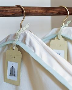 TIP: Use photo labeled garment bags to store your out of season clothing. The garment bag will protect your clothing and the label will help you change seasons with ease.