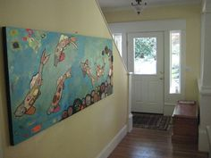 These koi fish needed to hang in a very HAPPY home!  Lovely Yellow Entrance!  #elihalpin #koi #fish