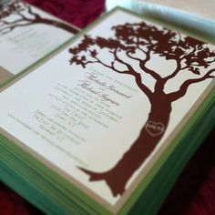 Rustic tree wedding invitation with carved initials.