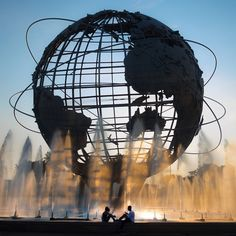 Unisphere, New York City, New York - A couple hangs out under the...