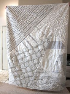 This would look awesome as a modern baby quilt - I think a splash of one light colour (like lime, pink, yellow) would be nice too!