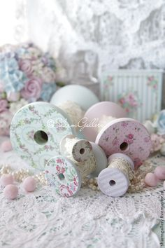 Gorgeous painted thread spools for holding bits of lace, trim, ribbon, etc.