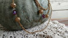 Check out this item in my Etsy shop https://www.etsy.com/listing/475997160/retro-gold-amethyst-necklace-vintage