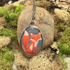 This gorgeous little necklace is handmade by me! This silver toned necklace has an oval shaped, 1.5 pendant with a fox print inside, filled with