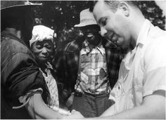 """Dr. Walter Edmondson takes blood from a man as part of the Tuskegee Syphilis Study. Researchers were also known to inject subjects with what they said was a cure. In fact it was often only aspirin.  """"The Tuskegee Study of Untreated Syphilis in the Negro Male"""" was a clinical study conducted between 1932 and 1972 in Tuskegee, Alabama in which 399 poor--and mostly illiterate--African American sharecroppers were denied treatment for syphilis. Photo creidt: National Archives"""