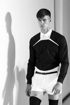 A man in thigh-high socks/tights and tennis shorts. Attire for the office.  Mugler SS 2013