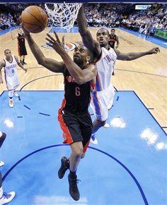 Toronto Raptors forward Alan Anderson (6) shoots in front of Oklahoma City Thunder forward Serge Ibaka , right, in the third quarter of an NBA basketball game in Oklahoma City, Sunday, April 8, 2012. Oklahoma City won 91-75.