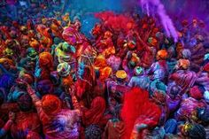 India's Holi Is Wild, Crazy, Colorful Fun!: Throwing colors during Holi is messy fun.