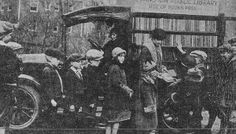 """The """"Pied Piper"""" bookmobile of Evanston, Illinois, circa 1920. The second bookmobile in the country, after small town Hibbing, Minn., and the first in a city. Former driver Charles Ferran wrote; """"'Honk! Honk! Honk!' goes an automobile horn on the corner… the children understand it and come flocking from all over the neighborhood crying, 'Libraree! Libraree!'"""" It was loaded with books in German, Italian, Polish, Swedish, and Norwegian for the many immigrants. (my hometown. rw)"""